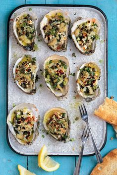 Crabmeat, feta, and capers are broiled atop garlic-and-herb-dressed oysters in this salty-sweet preparation from chef Jodi Perez of Wakulla Springs Lodge. Shellfish Recipes, Seafood Recipes, Cooking Recipes, Saveur Recipes, Ww Recipes, Seafood Dishes, Restaurant Recipes, Greek Recipes, Sandwich Recipes