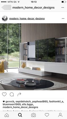 Modern White Gloss Entertainment Center With Sliding Black Glass Door And Bookshelves On The Sides Elegance For Your New Living Room