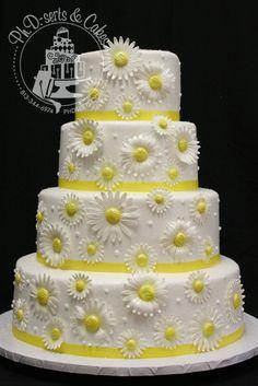 buttercream wedding cake with edible daisies
