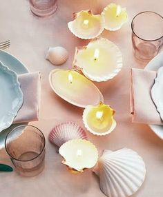Use sea shells to place your candles to show off a beautiful decorative shell candle centerpiece on your dining table. #KBHome