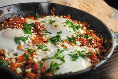 Eggs with tomato sauce and chickpeas