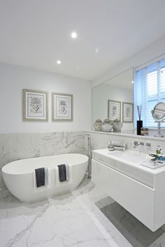 Half tiled marble-effect walls and floor create a dramatic footprint in this stunning contemporary bathroom design. Latest Bathroom Designs, Contemporary Bathroom Designs, Bathroom Modern, Staircase Contemporary, Modern Bathtub, Modern Sink, Modern Staircase, Modern Contemporary, Marble Tile Bathroom