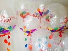 Rainbow confetti balloons sent by our client to celebrate their birthday. Corporate balloons by The Feather Balloon Company