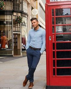 Coloured shirt with belted fancy pants.