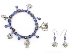 Nativity Scene Stretch Bracelet & Earrings MOL Jewelry. $22.00. Manger, star, angel and donkey charms are accented with blue and grey pearlized beads. Great Christmas Gift idea for family, friends, teachers, nurses, neighbors, girlfriends.. Comes with matching earrings. Bracelet features charms depicting the Nativity scene.