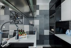 Mirror wall in small kitchen, black and white cabinets, grey style