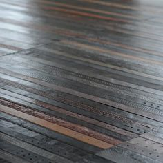 modular floor tiles made from recycled leather belts by London-based designers Ting