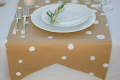 craft paper table runner w/ painted white polka dots...simple & clever!