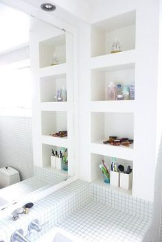 built in cut out bathroom shelves, white, light, modern