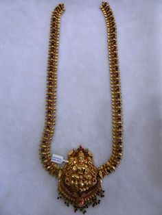 Sharada silver shop :	Nakas silver Necklace / Daadu with gold polish.