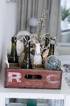 coastal beach decoration bottles, glass spheres in vintage crate  at Songbirdblog