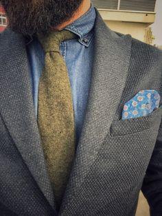 Navy blazer and haki tie....