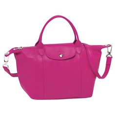 Longchamp Le Pliage Cuir. Leather and can be worn crossbody!