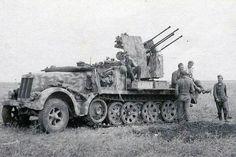 A anti aircraft gun crew with their Famo taking a break from duty.