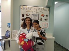 Isabel is our Quarterly Contest Winner and is so happy to be receiving her $50 Visa Gift Card from Dr. Ghafouri!