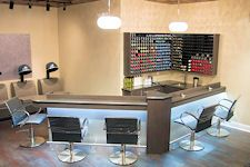 Salon Riccio Custom Manufactured and designed Color Bar with lighting, Strap chairs, matching corner color display organizer by Salon Interiors, Inc.