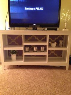 Finally decided on this threshold bookcase for my new tv stand. A little wall paper in the back to brighten it up.