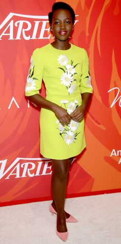 Leave it to Lupita Nyong'o to pull off the brightest shade in the rainbow—she wore a citron daisy-embroidered Dolce & Gabbana number at the Variety Power of Women event, complete with diamond studs and blush pink suede pumps.
