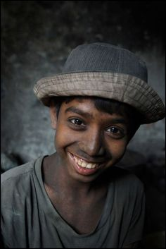 The Face of Child Labor by lootinjusttogetby:  10-year-old Roubel works at a factory making ornamental grilles for windows. He is already a skilled worker after working as an apprentice without pay for two years. He now earns 500 taka, or around 8 USD, a month.