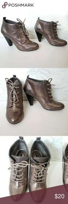 Metallic Pewter Lace Up Booties Very cute lace up metallic pewter booties from Forever 21. Size 7. Never worn still have tag on bottom of shoe.   * Has some scuffs on the inside part of shoes from rubbing against each other in my closet see pic . Also have some damage on the heels see pic. Forever 21 Shoes Ankle Boots & Booties