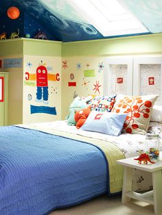 Robot Retreat--Once a single large room, the home's upstairs level is now two separate spaces, divided to accommodate two kids. In one half, space-theme walls are right at home under the ceiling covered in an outer space mural. Skylights let plenty of natural light into the room.