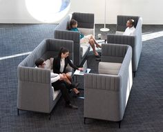 High-backed sofas placed together create instant semi-private meeting areas