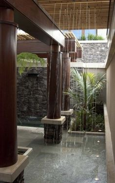 Now THIS is what to do with an outside area by the pool. Rainforest shower, lots of wood. Feel like I'm in the jungle.