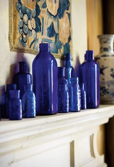 blue bottles on the mantle ... could do different colors