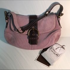 Coach Lilac Suede Shoulder Bag Pretty Pale Lilac Suede, Trimmed in Brown Leather. This has some superficial light markings on the Suede. This comes with a Suede Brush, and Suede Eraser that can gently erase the stains ( for the gal that has the time to put into it). In Pristine Condition otherwise, and EXTREMELY CLEAN Interior!  Magnetic Snap Closure w/ Brass Hardware. Adjustable Shoulder Strap. This has Two Main Compartments, One Inner Zipper Pocket & Two Multifunction Pockets. Slip Pocket…