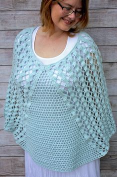 The Whimsical Waves Poncho is a free crochet pattern featuring Lion Brand's Feels Like Butta Yarn. A beachy, breezy and trendy addition to your summer wardrobe! A unique design featuring mesh filet triangle front panels with lacy and airy side panels to complete your summer design. A fun pattern with video tutorials!