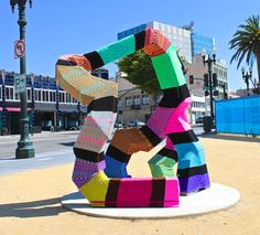 Ishknits, or Jessie Hemmons, is a yarnbomber who recently moved to Oakland, CA from Philadelphia, PA. Her work concentrates on facilitating a shift in the perception of street art, by using a typically feminine craft to inititate a dialogue on the relationship between gender and non-commissioned public art.