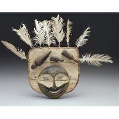Mask: spirit face, Yupik Eskimo, late 19th century, Geographic location: Lower Yukon River area, Alaska, United States, Wood, paint, feathers, and gut, Dallas Museum of Art, gift of Elizabeth H. Penn