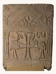 """Tombstone of Plenis Unknown provenance, 6th century  Tombstones from the early years of Christianity are often decorated with an architectural structure symbolizing the house of God. Various Christian symbols fill the lower part of this gravestone. In the centre is Christ's monogram, comprising the two Greek letters """"Chi"""" and """"Rho"""".  Here it is flanked by looped crosses (crux ansata), formerly the Egyptian Hieroglyph """"Ankh"""" (the key of life)."""