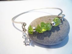Sterling Silver cuff bracelet, Peridot and silver, August birthstone, Green Peridot and silver bracelet, Star charm Sterling Silver Cuff Bracelet, Green Peridot, Silver Stars, Bracelet Sizes, Birthstones, Gemstones, Bracelets, Indie, Gift Ideas