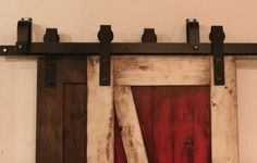 By-Pass barn door hardware works great for closet doors. http://rusticahardware.com/bypass-barn-door-hardware-system/