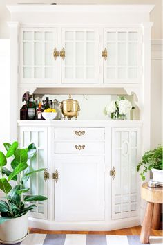 Great storage idea: add paper to hide clutter in a built-in. Next to the back door.