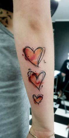 Watercolor Heart Arm Tattoo - MyBodiArt.com