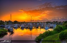 Majestic colors before sunrise at the Loggerhead Marina in  Palm Beach Gardens, Florida with boats docked. HDR image created using Photomatix Pro and Topaz software.