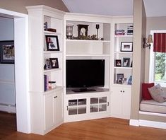 white corner media center/cabinets but with side cabinets not so bulky