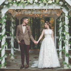 This high neck lace ball gown wedding dress is the perfect accent for a garden wedding | Shop this Oleg Cassini gown from David's Bridal Photo by Craig Obrist