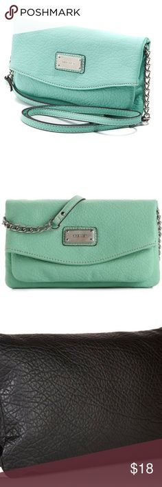 Nine West Mint Green Tunnel Cross Body Bag only used a few times; Excellent Condition, Organization that looks great, Faux leather construction, Magnetic snap closure, Crossbody strap with chain detail, Exterior boasts a polished logo plate. Lined interior with multiple zipper and slip pockets. Imported. Measurements: Bottom Width: 9 in Depth: 1 in Height: 5 in Strap Length: 48 in Strap Drop: 22 in Weight: 9 oz; last 2 pictures aren't the correct color; Nine West Bags Crossbody Bags