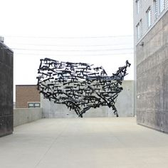 """""""Michael Murphy, whose assault rifle made from 1200 ping pong balls we posted last year, is back with another suspended installation, Gun Country, 130 toy guns on the roof of the Urban Institute for Contemporary Art in Grand Rapids, MI."""
