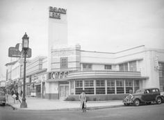 northwest corner of Detroit Street at Wilshire Boulevard: showing pedestrians outside the Melody Lane Cafe and Cocktail Lounge.