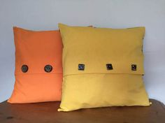 Tangerine and Sunshine Yellow cushions with a retro 1970's floral pattern on the reverse. See more in my Etsy store