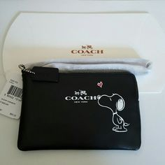 COACH SNOOPY WRISTLET New with tags black Coach Peanuts Snoopy wristlet. 2 credit card slots inside.  Limited edition. Gift box included. Coach Bags Clutches & Wristlets
