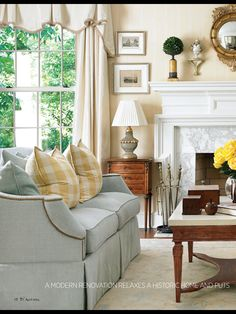 Traditional Home April 2014, sofa, buffalo check silk pillows, yellow Buffalo check fabric, lamp, silk curtains, room color palette, paint color palette, fabrics, traditional living room, blue linen sofa, antique side tables, S FINAL