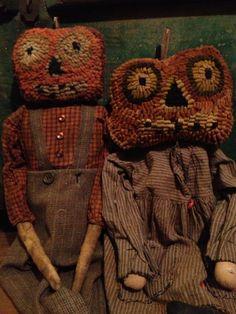 Hand hooked pumpkin head dolls...