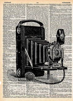 camera art print on dictionary page.