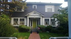 Gray house with lime green door