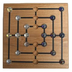 This classic two-player game has been played for some 3000 years. The goal is to strategically reduce your opponent from nine marbles to two. Constructed of beautiful solid oak with smooth glass marbl